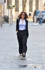 Myleene Klass Steps out after reportedly injuring her toe in black trouser suit in London