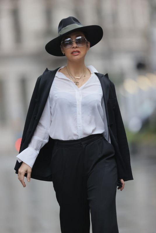 Myleene Klass Steps out at Smooth Radio Studios wearing a top hat and monochrome trouser suit in London