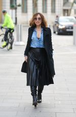 Myleene Klass Wears a stylish black dress and trench coat at Smooth Radio Studios in London