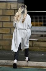 Olivia Attwood Seen chatting on her phone and drinking a brew in a pair of sandals in Manchester