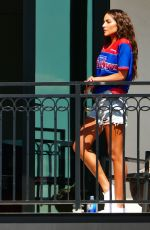 Olivia Culpo Relaxes on her VIP balcony at a hotel in Tampa, Florida