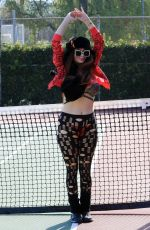 Phoebe Price Seen stretching and cleaning up her dog