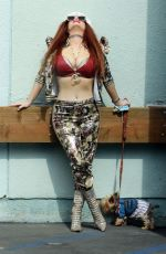 Phoebe Price Seen wearing a camouflage outfit and picking up dog food at Petco in Los Angeles