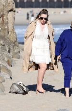 Rebel Wilson Enjoys a walk on the beach with her friend as the sun sets in Santa Barbara