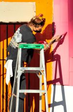 Tina Louise Helps paints her second location of her vegan restaurant Sugar Taco in Sherman Oaks