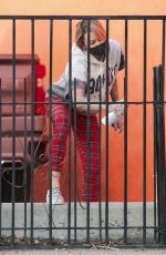 Tina Louise Spotted spray painting a fence outside her second location of her vegan restaurant Sugar Taco in Sherman Oaks