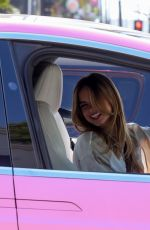 Addison Rae Smiles for the camera as she picks up food for a friend in Los Angeles