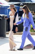 Alessandra Ambrosio Looking chic in a camel colored ensemble while getting coffee with a friend