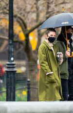 Annie Murphy Spends the day with a chivalrous mystery man that holds an umbrella over her head in New York
