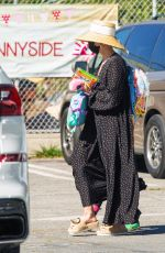 Ashlee Simpson Picks up her daughter wearing a straw hat and long dress in Los Angeles