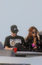 Bella Thorne Kicks back on a boat with friends in Miami Beach