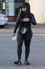 Blac Chyna Chats with an eager fan while leaving a nail salon with a mystery man and a friend in Los Angeles