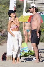 Camila Coelho Show her extremely toned physique as she gets into a friendly game of beach volleyball in Santa Monica