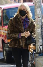 Chloe Sevigny Looks very fashionable with leopard coat while out with husband and baby in NYC