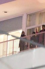 Demi Lovato Hangs out with friends on a balcony after a late show in Beverly Hills