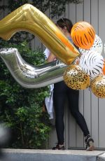 Elsa Pataky Receives a bundle of helium balloons ahead of her twins Birthday celebration in Sydney
