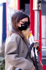 Emily Ratajkowski Walks home after lunching at Odeon restaurant with a friend in New York