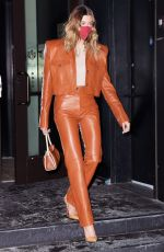 Hailey Bieber Wearing a tight leather suit while heading out in New York City
