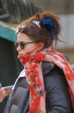 Helena Bonham Carter Wears what looks like a doyly around her neck and two pairs of specs on her head in London
