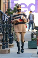 Irina Shayk Grabs coffee for herself and Bradley Cooper as they celebrate their daughter