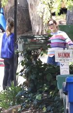 Jennifer Garner Chats with a neighbor outside her home