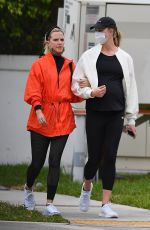 Karlie Kloss Walks arm-in-arm with a friend in Miami Beach