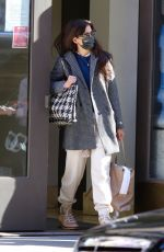 Katie Holmes Sports sweat pants and work boots after running errands at a midtown Manhattan office building