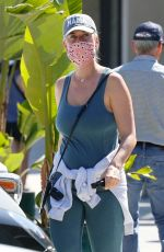 Katy Perry Pays tribute to baby Daisy with a name necklace and Daisy pendant while out shopping for socks in Santa Barbara
