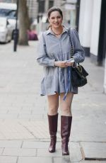 Kelly Brook In floaty minidress and burgundy knee high boots
