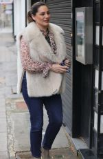 Kelly Brook Looks stylish in jeans and a frilly blouse at Heart radio in London