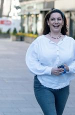 Kelly Brook Makes a summery display in a white blouse and skinny jeans at Heart radio