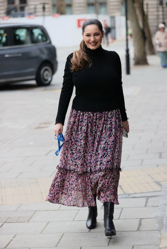 Kelly Brook Wears summer skirt and tight jumper at Heart radio appearance in London