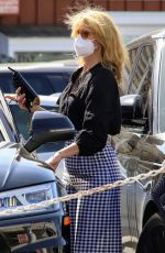 Laura Dern Seen running errands in a checkered skirt in Brentwood