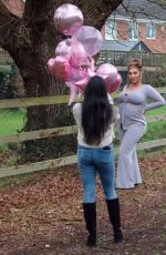Lauren Goodger Taking an Instagram snap with a bunch of pink balloons after revealing she is having a baby girl
