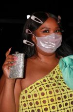 Lizzo Brings her own flask to dinner at Craig