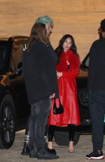 Megan Fox Is weaning a long red leather trench coat and PVC pants at Nobu Malibu