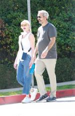 Melanie Griffith Joined by a male friend for a stroll in Beverly Hills
