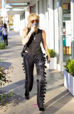 Miley Cyrus Rocks a stylish outfit while out in Beverly Hills