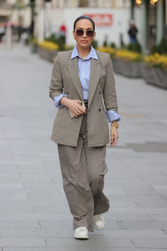 Myleene Klass Looks chic in wide legged trousers and tweed jacket for Smooth radio appearance in London