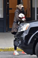 Olivia Palermo Wears a mask as she takes her dog to an UBER in New York City