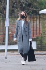 Olivia Wilde Grabs a morning coffee while out for a stroll in London