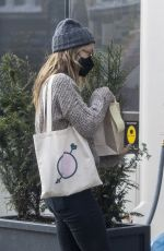 Olivia Wilde Seen grabbing some food from her local shop in London