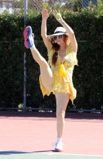 Phoebe Price Stretching and posing around at the park
