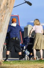 Rose Byrne Looks 80s chic in a retro denim outfit as she films