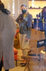 Sarah Jessica Parker helps customers at her South St. Seaport store Saturday afternoon in New York City