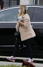 Sarah Michelle Gellar holds a bottle of Lysol as she runs some morning errands in Brentwood
