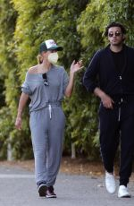 Sofia Richie and her new mystery man go for a romantic evening stroll in Los Angeles