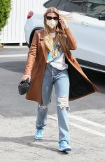 Sofia Richie Cuts a casual but elegant figure in a chestnut coat and ripped jeans as she steps out in Hollywood
