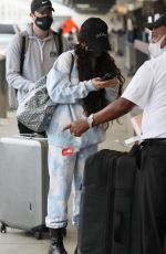 Vanessa Hudgens Getting ready to skip town with a friend in Los Angeles