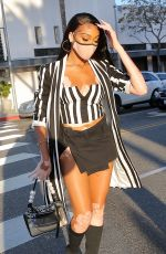 Winnie Harlow Puts on a leggy display as she steps out to dinner with friends at Wally